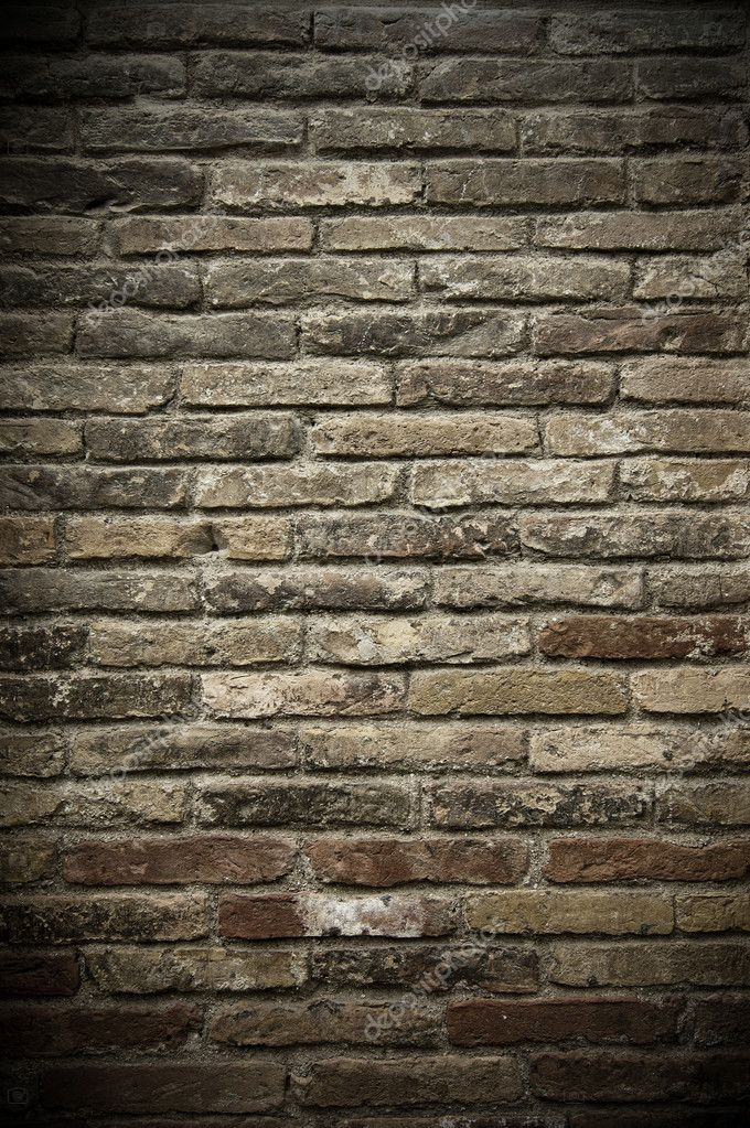 A wall of aged grey and red bricks — Stock Photo #3160075