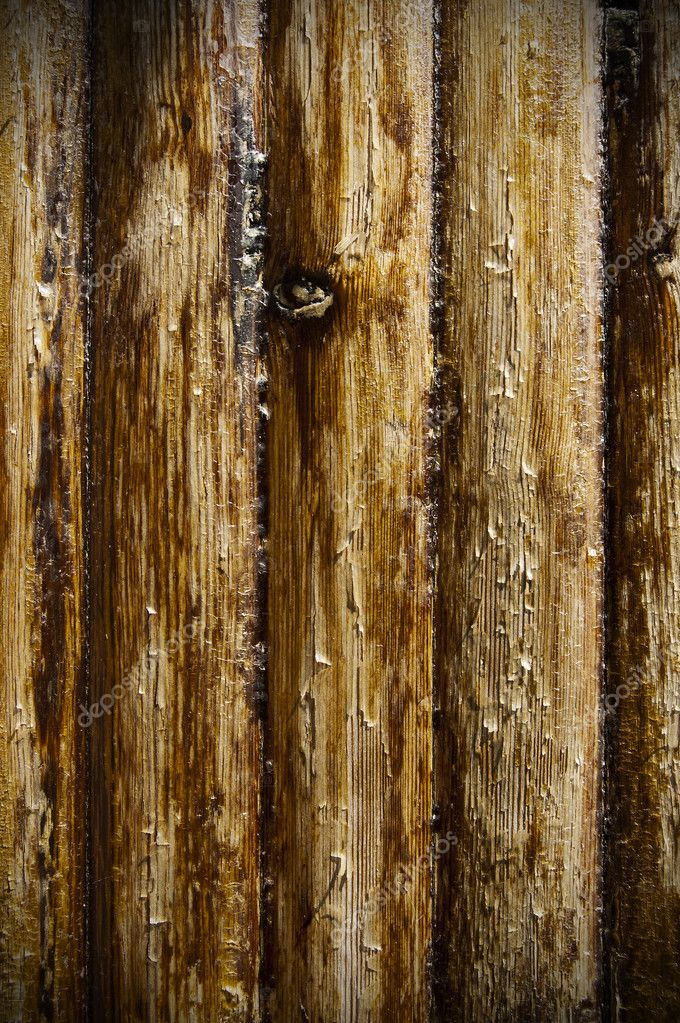 A brown plane of old rough wood — Stock Photo #3792699