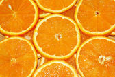 Background of the sliced orange plastic — Stock Photo