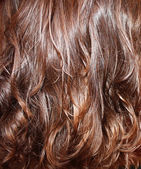 Background of wavy chestnut hair — Stock Photo