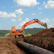 Stock Photo: Pipeline coming from storage tanks
