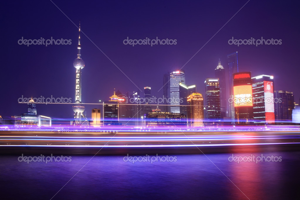 Night view of Shanghai with light traces from moving cruise ship  Stock Photo #3361482