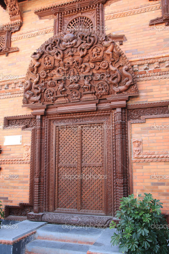 A luxurious decorative carved wooden door of buddhistic house, Nepal  — Stock Photo #3382283