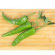 Green pepper on cutting board - Stock Photo