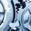 Stock Photo: Gears meshing together