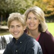 Mom and Son by Waterfall — Stock Photo #2844504