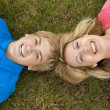 Stock Photo: Mom and Son Lying in Grass