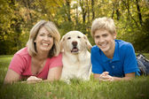Family Portrait with Dog — Stock Photo