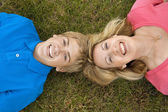 Mom and Son Lying in Grass — Stock Photo