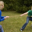 Mother and Son Tug of War — Stock Photo