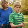 Son Ignoring Mother, Listening to Ipod — Stock Photo