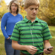 Son Ignoring Mother, Listening to Ipod - Stock Photo