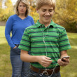 Son Ignoring Mother, Listening to Ipod — Stock Photo #3319784