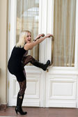 Funny young woman trying to open doors — Stock Photo
