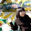 Stock Photo: Funny girl in an amusement park