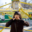 Funny girl in an amusement park — Stock Photo