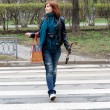 Girl crossing the street - Stock Photo