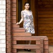 Girl standing on a veranda - Stock Photo