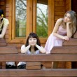 Three female friends on a veranda — Foto de Stock