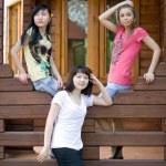 Three female friends on a veranda — Stock Photo #3362688