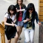 Three female friends rushing — Stock Photo #3362704