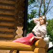 Girl sitting on veranda — Stock Photo #3363316