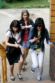 Three female friends rushing — Stock Photo