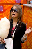 Girl eating candy floss — Stock Photo
