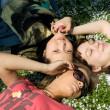 Girls lying on grass — Stock Photo #3387583