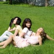 Stock Photo: Three girls sitting on grass