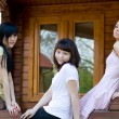 Stock Photo: Three female friends on a veranda