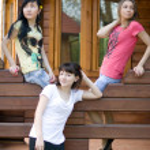 Three female friends on a veranda — Stock Photo #3387675