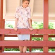 Girl standing on veranda — Stock Photo #3387975