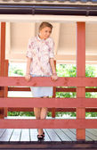 Girl standing on a veranda — Stock Photo