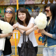 Three girls eating candy floss — Stock Photo #3451472