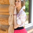 Girl standing on a veranda — Stock Photo