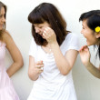 Three female friends standing — Foto de Stock