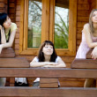 Three female friends on a veranda — Stock Photo
