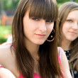 Two female friends sitting on bench — Stock Photo