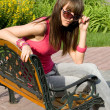 Girl sitting on bench — Foto de Stock