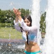 Girl bathing in a city fountain — Stock Photo #3497015