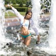 Girl bathing in a city fountain — Stock Photo #3497020