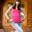 Girl standing on veranda — Stock Photo #3506833