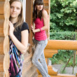 Two female friends on a veranda — Stock Photo