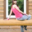 Girl sitting on veranda — Stock Photo #3569221