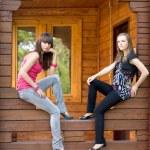 Two female friends on a veranda — Stock Photo