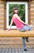 Girl sitting on a veranda — Stockfoto