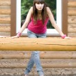 Girl standing on veranda — Stock Photo #3649766