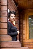 Garota de pé na varanda — Fotografia Stock