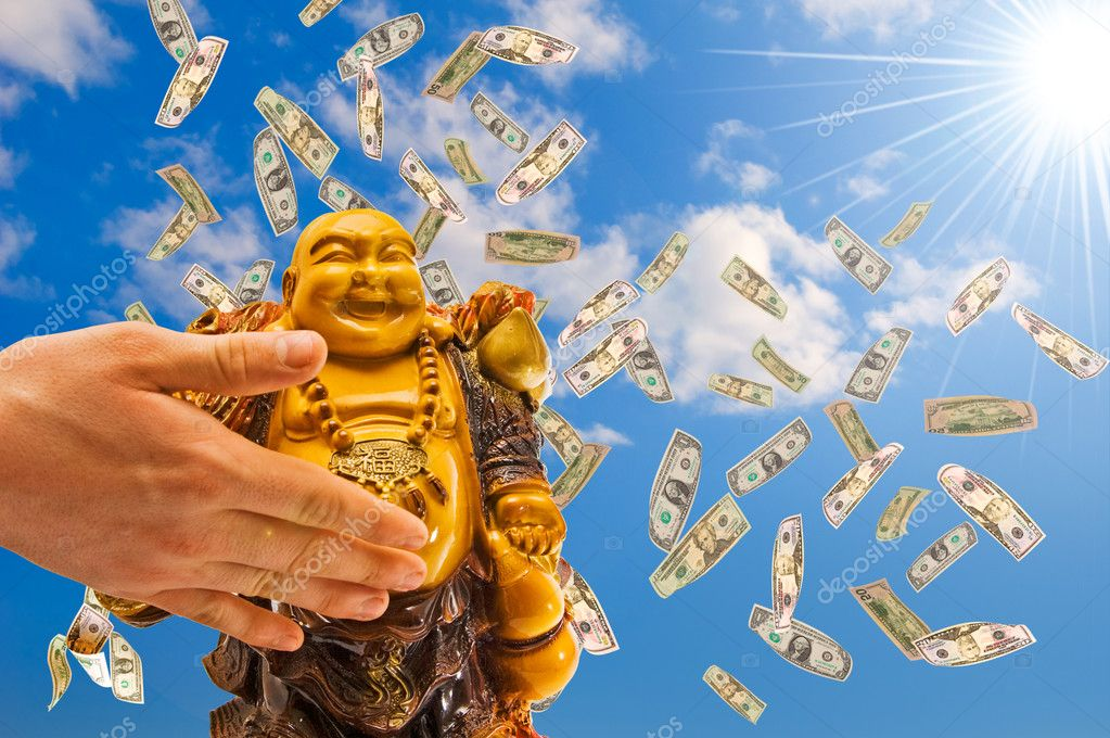 Feng shui. buddha against a blue sky with  falling  dollars.  Stock Photo #2976015